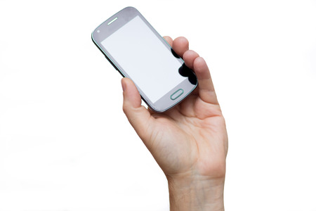 Smartphone in a hand outstretched on a white background Stock Photo