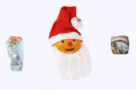 pumpkin dressed in santa claus with a gift for a child Фото со стока