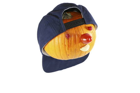 pumpkin in a blue cap and tie dressed for the celebration of heluin