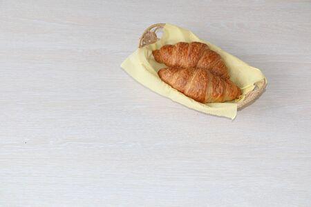 Healthy breakfast. A croissant in a beautiful wicker basket.