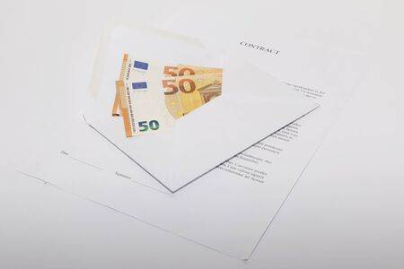 Business papers, contract and envelope with money on white background.