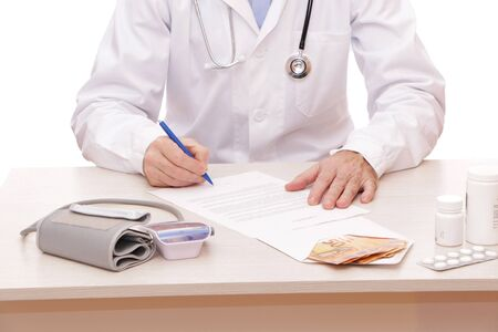 The doctor signs a contract with the patient. On the table is a money, medical instrument a stethoscope, a medical device for measuring the pressure for listening to the lungs and heart of a patient with headphones on a white background.