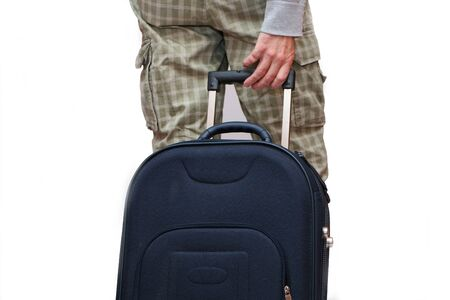 A man goes on vacation and pulls a suitcase from the back. Stock Photo