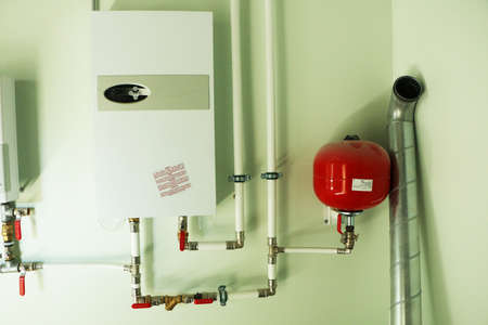 Construction of new water pipes. New water pipes and valves on the wall. Bathroom renovation.