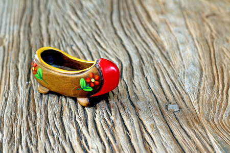 klompen: Traditional Turkish Single Clog With Atractive Style and Colorful on a wooden table