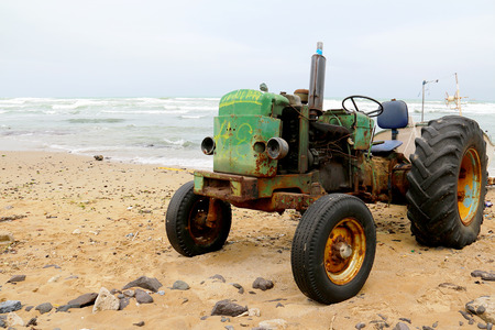 Image an Rusty Tractor on the Beach photo