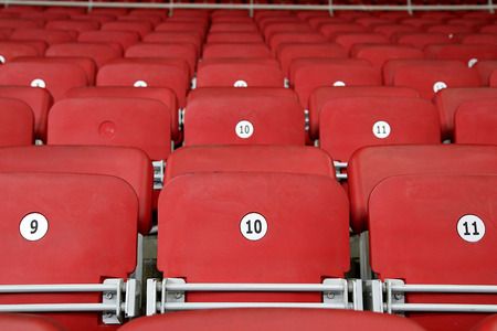 lines game: Empty Red Grandstand Stadium Seats Stock Photo