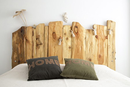 Wooden Bedroom Decoration with Sweet Pillows photo