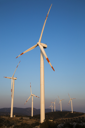 produce energy: Wind energy turbines are on the mountain and produce cleanest electric energy vertical