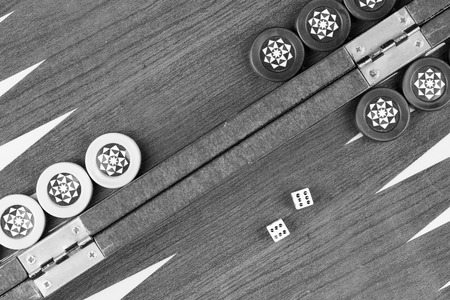 double the chances: Backgammon table and double six dice closeup black and white