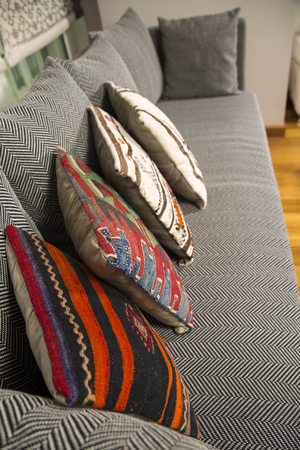 Herringbone sofa with traditional Turkish handmade colorful natural fabric pillows photo