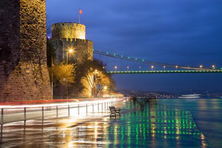 hisari: Rumeli Hisari (Rumeli Castle) and Fatih Sultan Mehmet Bridge background at Istanbul Turkey 2015