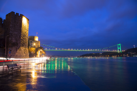 hisari: Rumeli Hisari (Rumeli Castle) and Fatih Sultan Mehmet Bridge background Istanbul 2015 Editorial