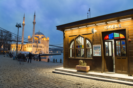 Night view of Ortakoy port with Ortakoy Mosque and Bosphorus Bridge background in Istanbul, Turkey