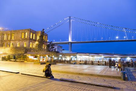 Historical Esma Sultan Mansion and Bosphorus Bridge twilight, night view located at Bosporus in Ortak?y neighborhood of Istanbul, Turkey photo