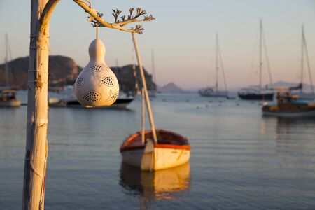 impiccata: White colored handmade ornaments hanged on a white painted tree as a decorative view Archivio Fotografico