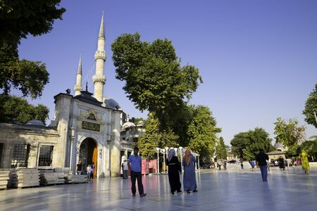 turkish people: Tourists and Turkish people walking near The Eyup Sultan Mosque Istanbul Turkey