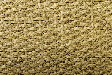 Horizontal view of hand made original brown colored wicker weave texture background