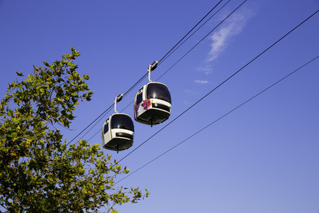 Two cable cars in motion in the air with  blue sky background Standard-Bild