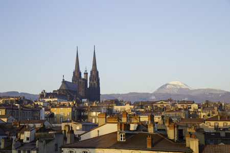 Roof top view of city center and volcano Puy de dome in Clermont ferrand, Auvergne, France