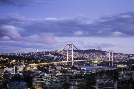 Twilight view of Bosphorus Bridge which is one of two suspension bridges spanning the Bosphorus strait in Istanbul Turkey