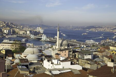 Rustem Pasa mosque with Galata and Bosphorus bridge near Golden Horn background view in Eminonu Istanbul Editorial