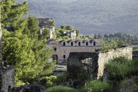 Abandoned Orthodox church ruins in Kayakoy village at south of Fethiye in southwestern of Turkey Standard-Bild