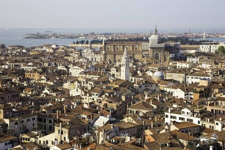 Aerial view of Venice cityscape with roofs of houses from San Marco bell tower, Italy
