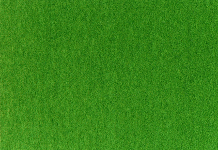 Green synthetic grass for model. photo