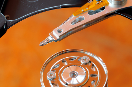 disk drive: A hard disk drive is a data storage device used for storing and retrieving digital information using rapidly rotating disks (platters) coated with magnetic material  hard disk drive