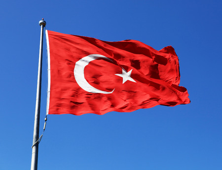 turkish flag: Turkish flag waving in blue sky