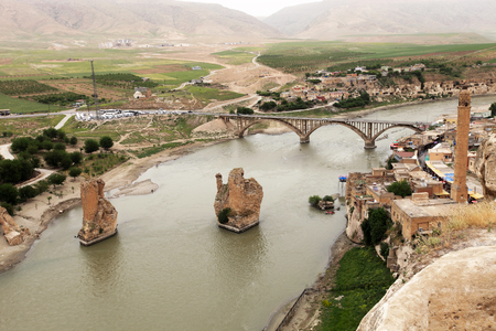 east river: Turkey. Hasankeyf village (Southeastern Anatolia). Aerial view from the Fortress on the Tigris River with remains of the Old Bridge (broken arches and pylons)