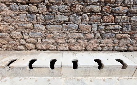 restored: Public multi-seat toilet at spectacular, well restored, antique ruins in Ephesus, Turkey Stock Photo