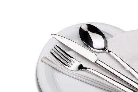 table knife: Fork, knife and spoon on a plate with napkin isolated on white. Clipping path. Stock Photo
