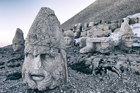 tumulus: The west terrace of Mount Nemrut with heads of the colossal statues and the tumulus.