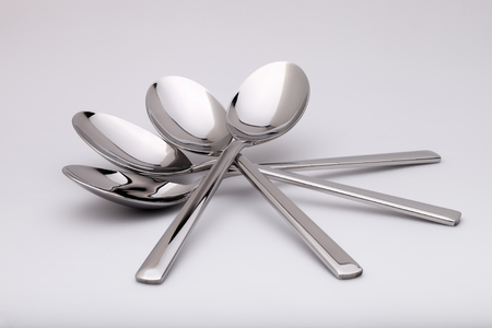 shiny metal background: the metal shiny spoon on white background