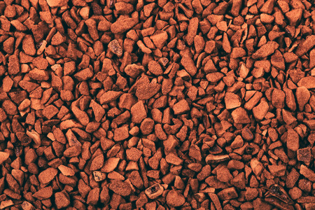 caffeinated: Instant coffee granules as an abstract background texture Stock Photo