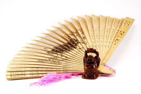 sandal tree: Figura de Buda en contra de un ventilador
