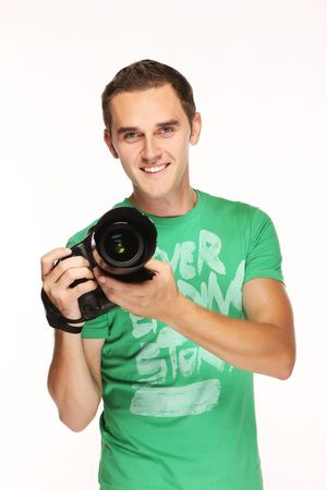 Young happy man with camera. Foto de archivo