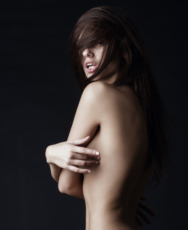 brunette naked: Fashion art photo of sexy naked lady with long healthy hair Stock Photo
