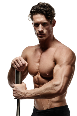 Handsome power athletic young man with great physique. Strong bodybuilder with six pack, perfect abs, shoulders, biceps, triceps and chest. Studio shot on white background Stock Photo