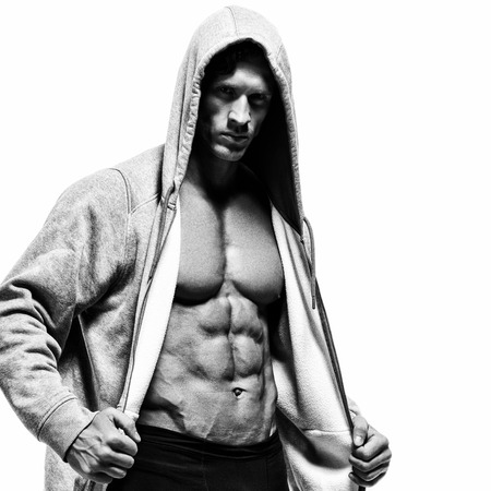 physique: Muscular man on a white background. Demonstration sportswear. Photos for sporting magazines and websites. Stock Photo