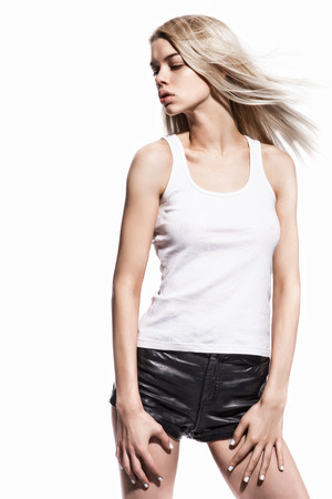 Fashion portrait of beautiful sexy blonde in leather short Stock Photo