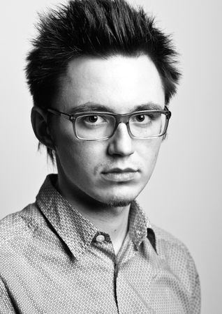 young handsome man with glasses and a shirt