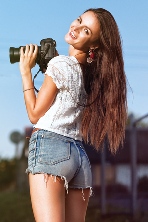 Portrait of a young beautiful photographer woman