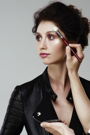 Making up the models face - professional makeup artist working Foto de archivo