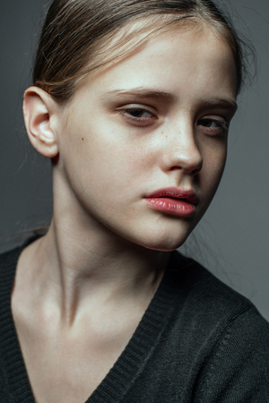 Close-up face portrait of young woman without make-up. Natural image without retouching .