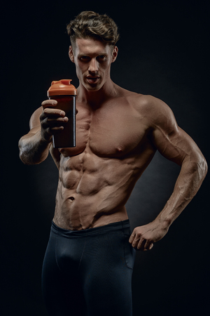 fitness instructor reminds drink fluids after exercise to restore the water-salt balance