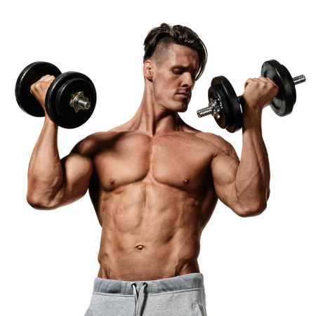 young man does exercises with dumbbells. isolated on white background
