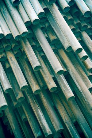 A stack of long cylinder turquoise pipes Stock Photo - 9476383